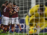 AS Roma's US midfielder Michael Bradley celebrates with teammates after scoring during the Serie A football match Udinese vs AS Roma at 'Stadio Friuli' in Udine on October 27, 2013
