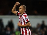 Wes Brown (#5) of Sunderland celebrates scoring his teams third goal of the game during the Barclays Premier League match between Queens Park Rangers and Sunderland at Loftus Road on December 21, 2011
