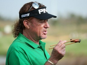 Miguel Angel Jimenez holds his cigar with a pair of chopsticks during the pro-am round ahead of the BMW Masters in Shanghai on October 23, 2013