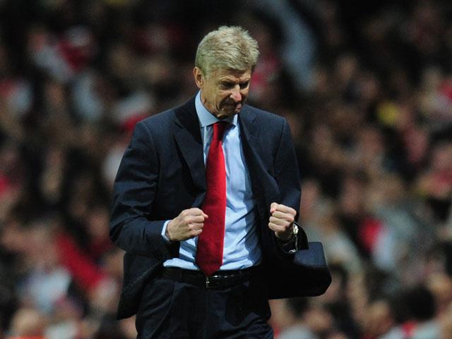 Manager Arsene Wenger of Arsenal celebrates after Olivier Giroud of Arsenal equalises making it 1-1 during the UEFA Champions League Group F match between Arsenal and Borussia Dortmund at Emirates Stadium on October 22, 2013