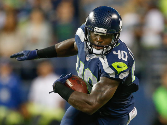 Running back Derrick Coleman #40 of the Seattle Seahawks rushes against the Oakland Raiders at CenturyLink Field on August 29, 2013