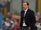 AC Milan head coach Massimiliano Allegri reacts during the Serie A match between AC Milan and ACF Fiorentina at Stadio Giuseppe Meazza on November 2, 2013