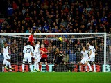 Steven Caulker of Cardiff City rise highest to score their first goal with a header during the Barclays Premier League match between Cardiff City and Swansea City at Cardiff City Stadium on November 3, 2013