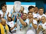 England's Chris Robshaw holds up the trophy after victory over Australia during the QBE International match on November 2, 2013