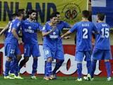 Getafe's players celebrate their second goal during the Spanish league football match Villarreal CF vs Getafe CF at El Madrigal stadium in Villareal on October 31, 2013