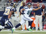 Golden Tate of the Seattle Seahawks celebrates as he runs for a touchdown during the 14-9 victory over the the St. Louis Rams at Edward Jones Dome on October 28, 2013