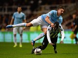 Man City's Javi Garcia and Newcastle's Massadio Haidara battle for the ball during their Capital One Cup Fourth Round match on October 30, 2013