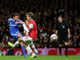 Juan Mata of Chelsea shoots to score his side's second goal during the Capital One Cup Fourth Round match against Arsenal on October 29, 2013