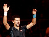 Novak Djokovic celebrates his win over Stanislas Wawrinka during the quarter finals of the Paris Masters on November 1, 2013