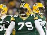 Defensive end Ryan Pickett #79 of the Green Bay Packers reacts in front of teammates inside linebacker A.J. Hawk #50 and nose tackle B.J. Raji #90 in the second quarter against the Minnesota Vikings during the NFC Wild Card Playoff game at Lambeau Field o