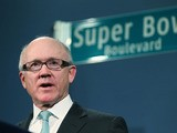New York Jets owner Woody Johnson speaks at a City Hall press conference announcing plans for Super Bowl XLVIII in the region on January 24, 2012