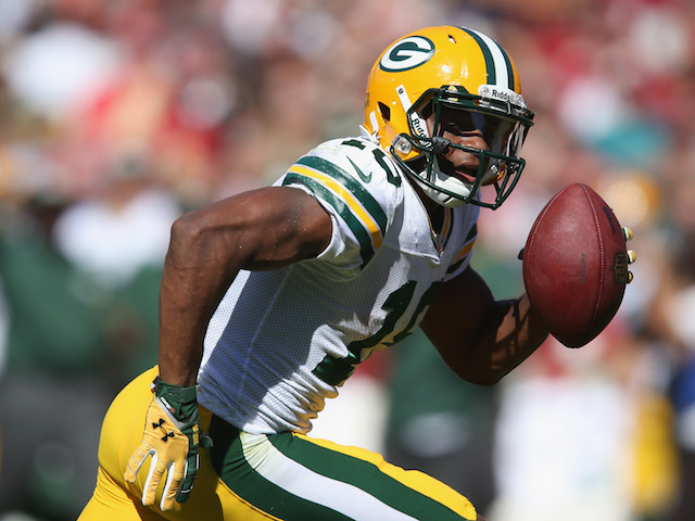 Wide receiver Randall Cobb of the Green Bay Packers carries the ball against the San Francisco 49ers at Candlestick Park on September 8, 2013