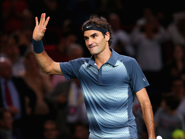 Roger Federer celebrates his win over Kevin Anderson during round two of the Paris Masters on October 30, 2013