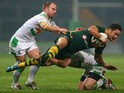Jarryd Hayne of Australia is tackled by Pat Richards and Liam Finn of Ireland during the Rugby League World Cup Group A match between Australia and Ireland on November 9, 2013