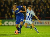 Harry Pell of AFC battles with Carl Baker of Coventry during the FA Cup First Round match between AFC Wimbledon and Coventry City at The Cherry Red Records Stadium on November 8, 2013