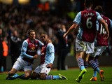 Leandro Bacuna of Aston Villa is congratulated by teammates after scoring the opening goal during the Barclays Premier League match between Aston Villa and Cardiff City at Villa Park on November 9, 2013