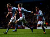 Libor Kozak #27 of Aston Villa celebrates with teammates after scoring his team's second goal past goalkeeper David Marshall of Cardiff during the Barclays Premier League match between Aston Villa and Cardiff City at Villa Park on November 9, 2013