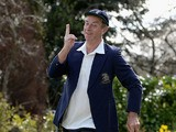 Former England cricketer and television commentator David 'Bumble' Lloyd poses in his MCC jacket and England cap at his home on April 23, 2013