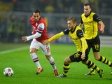 Dortmund's Polish midfielder Jakub Blaszczykowski, Dortmund's midfielder Kevin Großkreutz  and Arsenal's Spanish midfielder Santi Cazorla vie for the ball during the UEFA Champions League group F football match Borussia Dortmund vs Arsenal London in Do