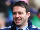 Bolton Wanderers manager Dougie Freedman smiles ahead of a match on January 26, 2013