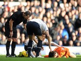 Hugo Lloris of Tottenham Hotspur lies injured during the Barclays Premier League match between Everton and Tottenham Hotspur at Goodison Park on November 03, 2013