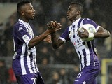 Toulouse midfielder Issiaga Sylla celebrates with teammate after scoring a goal during a French L1 football match against Ajaccio on November 9, 2013