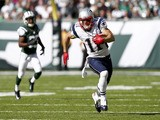 Julian Edelman of the New England Patriots runs against the New York Jets during their game at MetLife Stadium on October 20, 2013