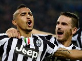 Juventus' midfielder Arturo Vidal of Chile is congratulated by Juventus' defender Leonardo Bonucci after scoring a goal during the UEFA Champions League Group B football match Juventus vs Real Madrid at the Juventus stadium in Turin on November 5, 2013