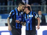 Atalanta's Marko Livaja celebrates with team mate Luca Cigarini after scoring his team's second goal against Bologna on November 10, 2013