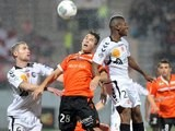 Lorient's midfielder Maxime Barthelme vies with Reims' forward Floyd Ayite and midfielder Antoine Devaux during the French L1 football match