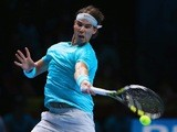 Rafael Nadal of Spain hits a forehand in his men's singles match against David Ferrer of Spain during day two of the Barclays ATP World Tour Finals at O2 Arena on November 5, 2013