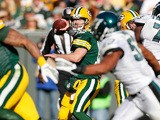 Scott Tolzien of the Green Bay Packers throws a second quarter pass while playing the Philadelphia Eagles at Lambeau Field on November 10, 2013