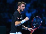 Stanislas Wawrinka of Switzerland celebrates a point in his men's singles match against Tomas Berdych of the Czech Republic during day one of the Barclays ATP World Tour Finals at O2 Arena on November 4, 2013