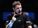 Switzerland's Stanislas Wawrinka celebrates winning a game on the way to beating Spain's David Ferrer during their group A singles match in the round robin stage on the fifth day of the ATP World Tour Finals tennis tournament in London on November 8, 2013