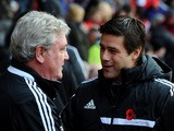 Steve Bruce manager of Hull City and Mauricio Pochettino manager of Southampton shake hands prior to prior to the Barclays Premier League match on November 9, 2013