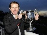 Tony McCoy poses with his trophy marking his 4000th career victory at Towcester racecourse on November 07, 2013