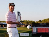 Victor Dubuisson celebrates with the trophy after winning the Turkish Airlines Open on November 10, 2013