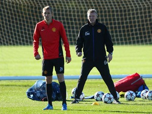 David Moyes the manager of Manchester United and Darren Fletcher look on at Aon Training Complex on November 4, 2013