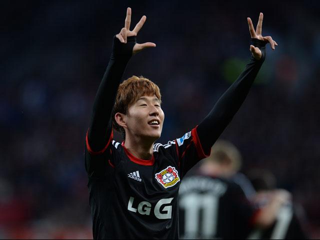 Leverkusen's South Korean striker Heung Min Son celebrates his third goal prior to the German first division Bundesliga football match Bayer Leverkusen vs Hamburger SV in the German city of Leverkusen on November 9, 2013