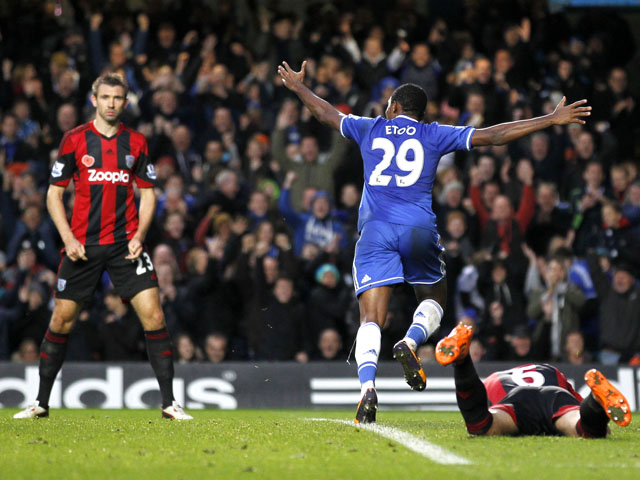 Chelsea's Cameroonian striker Samuel Eto'o celebrates scoring the opening goal during the English Premier League football match between Chelsea and West Bromwich Albion at Stamford Bridge in west London on November 9, 2013