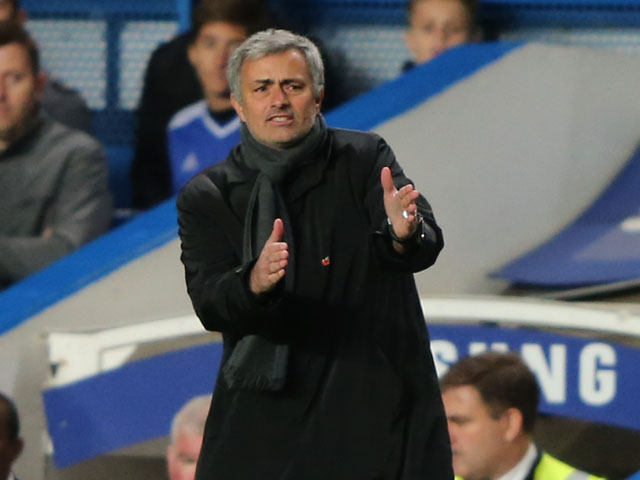 Jose Mourinho the Chelsea manager reacts during the Barclays Premier League match between Chelsea and West Bromwich Albion at Stamford Bridge on November 9, 2013