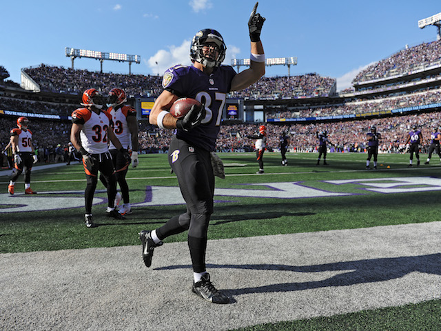 Tight end Dallas Clark of the Baltimore Ravens celebrates after scoring a touchdown against the Cincinnati Bengals in the first quarter at M&T Bank Stadium on November 10, 2013