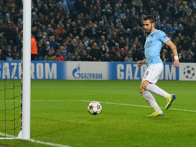 Manchester City's Spanish forward �lvaro Negredo scores the fourth goal during the UEFA Champions League group D football match between Manchester City and CSKA Moscow at The City of Manchester stadium in Manchester, north-west England on November 5, 2