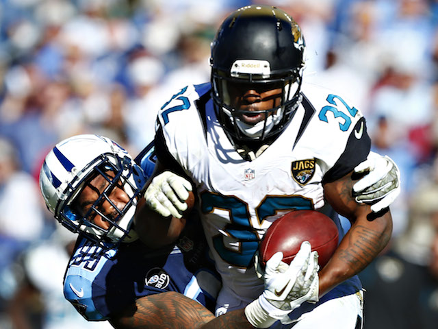 Maurice Jones-Drew of the Jacksonville Jaguars rushes the ball against Jurrell Casey #99 of the Tennessee Titans at LP Field on November 10, 2013