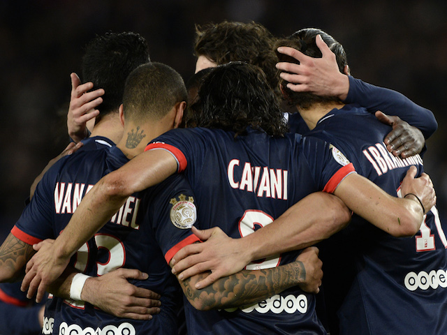Paris Saint-Germain's players celebrate after scoring their second goal from the penalty spot during the French L1 football match between PSG and Nice on November 9, 2013