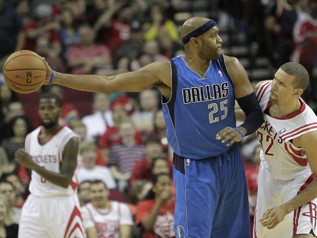 Vince Carter #25 of the Dallas Mavericks keeps the ball away from Francisco Garcia #32 of the Houston Rockets at Toyota Center on November 1, 2013