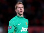 Ben Amos of Manchester United looks on during the Carling Cup Quarter Final match between Manchester United and Crystal Palace at Old Trafford on November 30, 2011