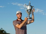 Chris Kirk poses with the trophy after winning The McGladrey Classic at Sea Island's Seaside Course on November 10, 2013