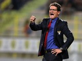 Russia's head coach Fabio Capello speaks to his players during his teams friendly international football match against Serbia in Dubai's Al Wasl stadium on November 15, 2013