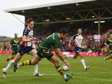 Jarryd Hayne of Australia scores a try as Daniel Howard of USA looks on during the Rugby League World Cup Quarter Final match between Australia and USA